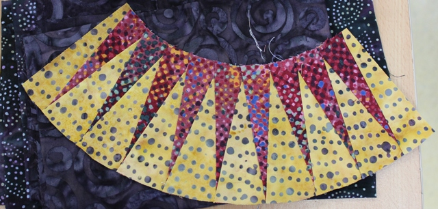 "Tricia practiced paper foundation piecing of New York Beauty arcs, using the Valori Wells' book ""Radiant New York Beauties""- from the library"